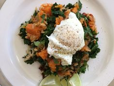 Brown Rice, Kale and Roasted Sweet Potato Sauté with Poached Eggs Recipe with olive oil, yellow onion, garlic cloves, salt, kale, cooked brown rice, sweet potatoes, lime, chopped cilantro, eggs