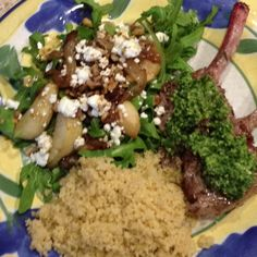 Voila! Dinner is served ( grilled lamb chops with mint pesto, arugula salad with caramelized onions, sautéed pears, walnuts and goat cheese, and couscous)