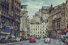 Bucharest, Romania - March 16, 2014: Picturesque cityscape with Victory Avenue (Calea Victoriei), a major avenue in central Bucharest, lined with fashion shops, art boutiques, hotels and restaurants.