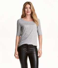 Gray melange. Top in soft, gently draping jersey with elbow-length sleeves and a rounded hem.