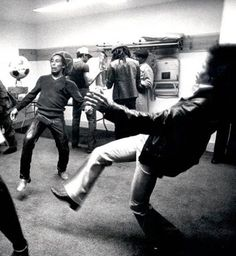 Photos of Famous Musicians Playing Sport-Bob Marley and Jimi Hendrix fooling around with a soccer ball backstage