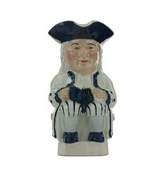 This is a marvelous vintage Toby jug from Wood & Son, England. This jug or mug is an elderly man, wearing a tricorn hat, sitting on a chair,