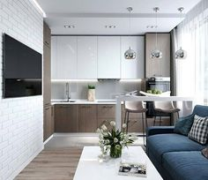 clean and minimal modern kitchen and living area. white and wood