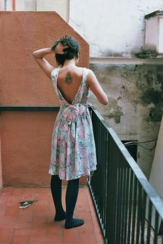 Short hair, dress, and tattoos.    This is the kind of feminine I want to be.