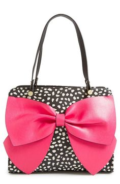 Free shipping and returns on Betsey Johnson 'Bow Regard - Large' Satchel at Nordstrom.com. An extravagant, sparkly bow takes center stage on a faux-leather satchel with a structured silhouette. Plenty of pockets and a tethered key clip help to keep you organized, while a logo-print lining in a lively color-pop hue will make you smile.