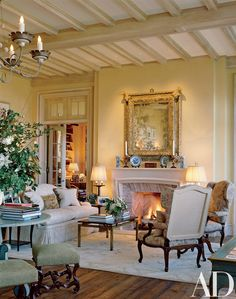 Coffered ceilings, a limestone fireplace and reclaimed-oak floors give texture to a seating area in the great room