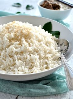 Fluffy coconut rice in a white bowl, ready to be served. Fluffy coconut rice in a white bowl, ready to be served. Rice Recipes, Indian Food Recipes, Asian Recipes, Cooking Recipes, Asian Foods, Cooking Rice, Savoury Recipes, Chinese Recipes, Cream Recipes