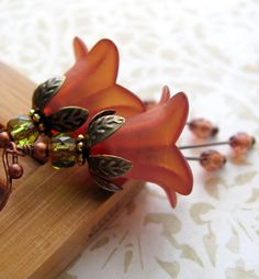 Hey, I found this really awesome Etsy listing at https://www.etsy.com/listing/74424224/saffron-orange-flower-earrings-rust