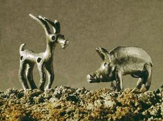 Elk and boar / Celtic bronzes / 1st-cBC.Pre– and early history: Sculptures etc.  Elk and boar.  Bronze statuettes. Celtic, 1st-century B.C. Height 6.3 and 5.6cm. Finding place: Gutenberg near Balzers (Liechtenstein).
