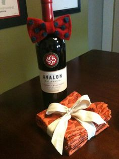 """@ValBrownDesign photo: """"1 of my best friends just moved to my block! :D @worldmarket napkins & a bow-tied bottle of wine housewarming gift!"""""""