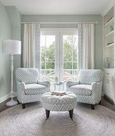 love the subtle pattern of the chairs and how it's repeated as a border on the drapes