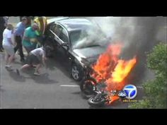 Passersby save motorcyclist trapped under burning car.... the whole damn lot of you people are bad asses!!! kudos to you!