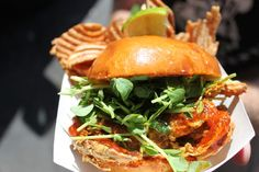 The Chomp Chomp food truck featured a softshell crab sandwich with taro root chips at the Doheny Surf Festival on Saturday, August 11th 2012.  Among the array of food trucks with unique creations and flavors, Chomp Chomp Nation showcased a variety of flavors that seemed to attract crowds. The softshell crab sandwich with Taro Root chips and Tiger slaw, a homemade veggie and fruit slaw mixed with a lemongrass vinaigrette, complete on a brioche bun kept patrons coming back for more.