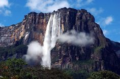 Angel Falls is a waterfall in Venezuela. It is the world's highest uninterrupted waterfall, with a height of 979 m ft) and a plunge… Isla Margarita, Angel Falls Venezuela, Paradise Falls, High Falls, Portugal, Beautiful Waterfalls, Natural Waterfalls, Belleza Natural, Natural Wonders