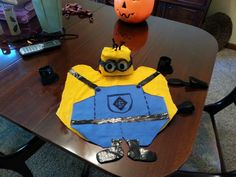 Made my doggie's halloween costume for local parade.  Used flour sacks and painted with multi purpose paint.  Also used felt for overalls and made boots with shiny duck tape and elastic bands to hold it on her.  #minion #diy #dog costume