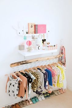 Organize baby clothes on an accent wall