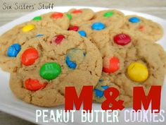 Peanut Butter M Cookies- these are a classic! SixSistersStuff.com #cookies #dessert #peanutbutter