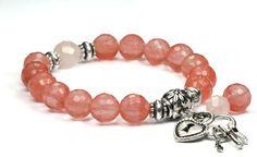 Check out this item in my Etsy shop https://www.etsy.com/listing/150278486/cherry-quartz-rose-quartz-charm-bracelet