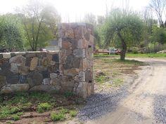 gate entrance stone pillars   stones