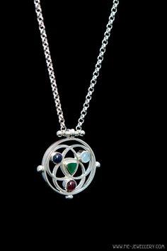 Silver Borromean rings pendant set with sapphire, aquamarine, garnet and triangle cut emerald Pendant Set, Pendant Necklace, Handmade Jewellery, Garnet, Emerald, Triangle, Sapphire, Diamond, Rings