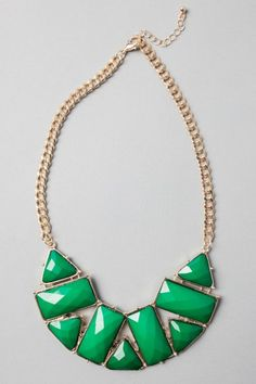 Emerald-coloured stones with gold chain