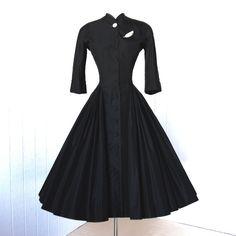 vintage 1940's dress ...rare exquisite designer couture NETTIE ROSENSTEIN black silk full skirt pleated swag shirtwaist cocktail dress. $590.00, via Etsy.