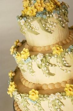 Lily Of The Valley.. This looks almost identical to my wedding cake except I had more pink and lavender flowers and less yellow daffodils.  Brings back memories!!