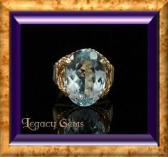 Pastel Blue Topaz Wire Wrapped by the Legendary Jim Fowler.  Yellow Gold