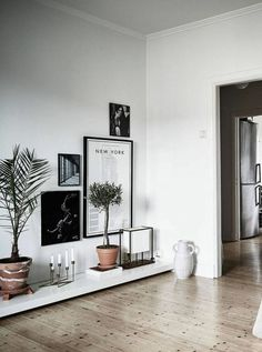 love this idea of a super low display bench to fix an awkward space in the house.  love.