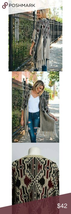 Oatmeal Knit Ruana This Item features geometric Patterns and Tasseled Bottom Trim Perfect to Pair with your favorite casual Look! Accessories Scarves & Wraps