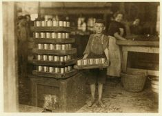 ::::::::: Vintage Photograph :::::::::   Farrand Packing Company in 1909.  A worker - a young boy with no shoes works full time. Photograph by Lewis Hine