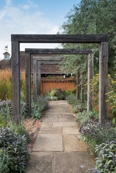 An oak pergola, weathered to an attractive silver gray, marks the entrance to th. - An oak pergola, weathered to an attractive silver gray, marks the entrance to th… An oak pergol - Garden Arbor, Diy Garden, Dream Garden, Garden Paths, Walkway Garden, Front Garden Entrance, Garden Arches, Front Garden Path, Front Path