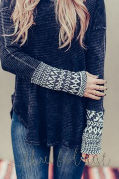 Daringly soft this exquisite mineral washed thermal is an exclusive Three Bird Nest design with extra long cozy arms featuring a knitted Aztec sweater cuff sleeve, rounded hem, lounge cut crew neck to