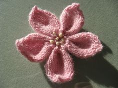 """Knitted Flower"" by Strikkelise, who says: ""This pattern can be used with any yarn you like. I personally think it works best with a rather thin yarn.""  many knitters' examples via the link.   [Find more of Aunt Ruth's favorite knitting tech pins at https://www.pinterest.com/yrauntruth/fiber-knit-techniques-tutorials/ ]"