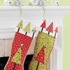 Festive foundation-pieced trees adorn a pair of stockings. Make several in  seasonal colors to decorate your mantel.