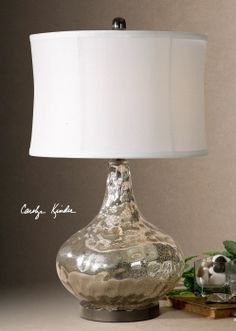 The glass on this lamp is finished from the inside with lightly antiqued, crackled, polished chrome.