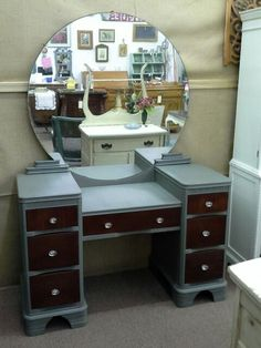 $225 - This vintage vanity has original round mirror, 7 drawers for storage and new drawer pulls. It has been painted gray, distressed and finished with a hand applied tinted wax with mahogany drawer faces. ***** In Booth E5 at Main Street Antique Mall 7260 E Main St (east of Power RD on MAIN STREET) Mesa Az 85207 **** Open 7 days a week 10:00AM-5:30PM **** Call for more information 480 924 1122 **** We Accept cash, debit, VISA, Mastercard, Discover or American Express