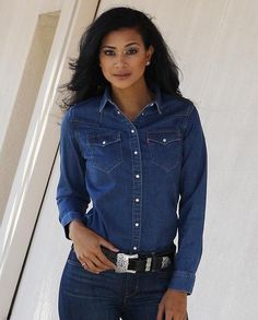 Levi's Ladies Stonewash Tailored Fit Snap Western ShirtThis long sleeve shirt features a spread collar, front and back western yokes, two snap flap pockets and snap closure. Made of 76% Cotton / 22% Polyester.Imported