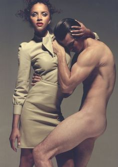 This photo is ironic because it goes against social norms. Most people believe the men to be the strong powerful protector and in this photo the man is naked and positioned in a very vulnerable position. Most people would be uncomfortable with this picture because men are supposed to be masculine and strong, not weak and vulnerable.