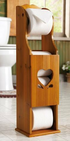 "Wooden Heart Toilet Paper Storage Holder By Collections Etc by Mallory Lane. $19.99. Cut-out is the perfect solution for storing extra rolls. Features a heart cut-out on the front. Charming wooden toilet paper holder. Measures 61/4""L x 6""W x 243/4""H. Charming wooden toilet paper holder features a heart cut-out on the front and is the perfect solution for storing extra rolls. Assembly required. 61/4""L x 6""W x 243/4""H."