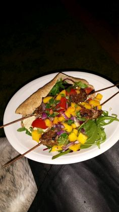 Homemade lean lamb kebabs with wholemeal pittas houmous and spicey mango salsa