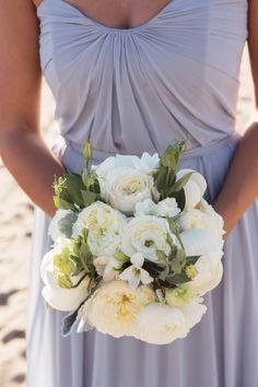 Garden roses and ranunculus: http://www.stylemepretty.com/california-weddings/2015/05/27/romantic-winter-wedding-at-verandas-beach-house/ | Photography: Ryon Lockhart - http://www.ryonlockhart.com/