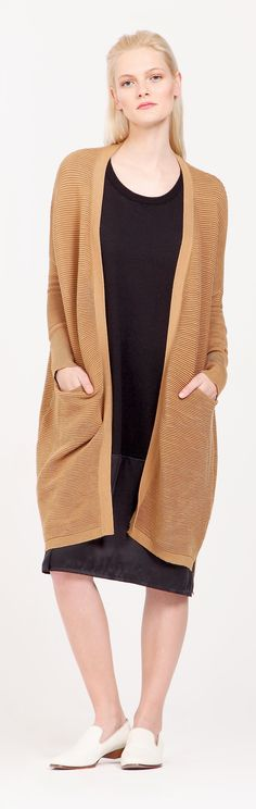 A sleek, longline cardigan version of our signature ribbed jumper, this camel knee-length cardigan is designed with fitted cuffs and side pockets. http://www.paisie.com/collections/knitwear/products/ribbed-knee-length-cardigan