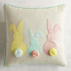 Celebrate spring with our pillow boasting pastel bunnies with pompom tails. A fun mix of color, appliques and a touch of metallic gleam, it might be just the thing to get your house hopping.