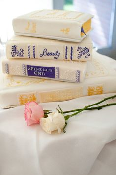 Love-story book wedding cake; Bible on top, Jane Austen on bottom, two Robin McKinley's in the middle.