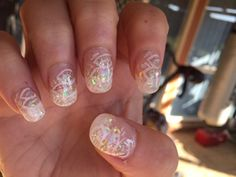 Gel manicure tips with glitter and hand painted design
