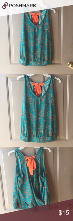 Very cute summer top Super cute teal and orange summer top. The back is open somewhat with a bow at the top. Lily Star size XL lily star Tops Blouses