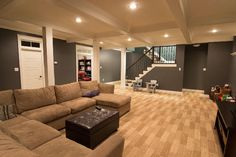 exact feel I'd want for basement, nice lighting, comfortable couch, soft looking carpet