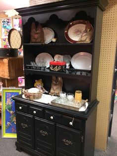 This is a great painted black two piece hutch, $180, from dealer BM at The Rusty Chandelier. We are packed full of fantastic furniture, vintage finds, home decor and gifts, many one of a kind created or recreated by our talented vendors. An eclectic mix of old and new treasures. Come explore for yourself! Open everyday 9-6!  I-29 and Highway 71, St. Joseph, MO