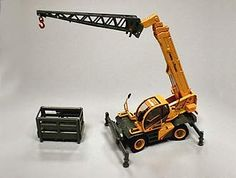 This Diedi Pegasus 50.21 Diecast Model Crane is Yellow and features working lift arm, rotating cab, stabilisers, wheels. It is made by ROS and is 1:50 scale (approx. 14cm / 5.5in long).  ...